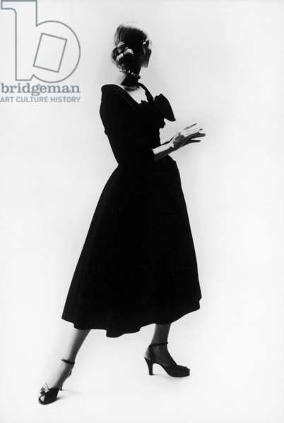FASHION: DIOR, 1947 Black wool 'New Look' dress by Christian Dior, 1947, photographed by Cecil Beaton.