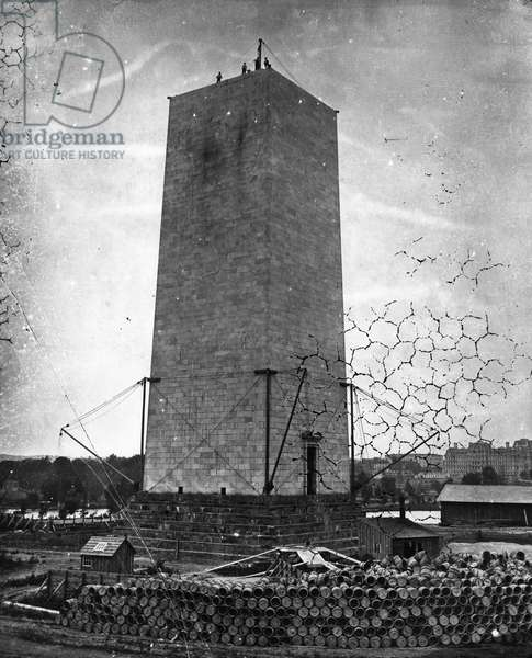 WASHINGTON MONUMENT, 1876 A view of the partially constructed Washington Monument in Washington, D.C. Photographed in 1876, when construction was resumed after a delay of about twenty years.
