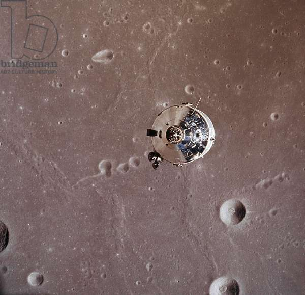 APOLLO 11: MODULE, 1969 The Apollo 11 Command/Service modules photographed from the Lunar Module in lunar orbit during the Apollo 11 lunar landing mission, 20 July 1969. The lunar surface below is in the Sea of Fertility.