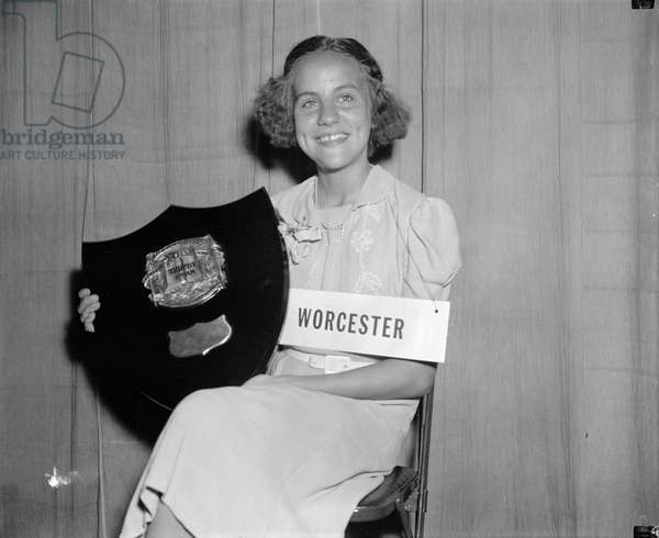 SPELLING BEE WINNER, 1939 Elizabeth Rice, 12-year-old eighth grade student from Worcester, Massachusettes, photographed with the plaque she received for winning the 1939 National Spelling Bee in Washington, D.C. Photograph, 29 May 1939.