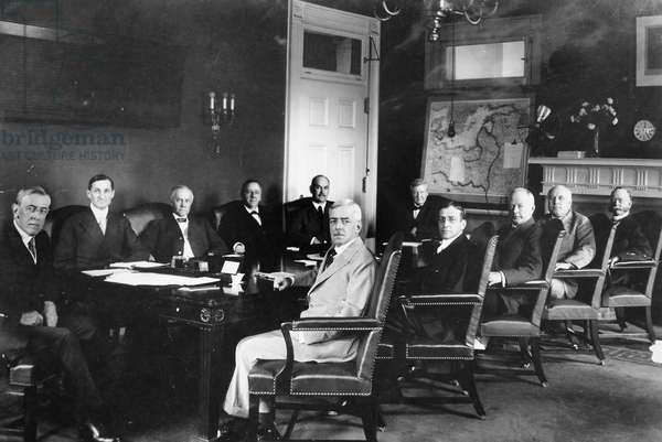 WOODROW WILSON & CABINET President Woodrow Wilson and his Cabinet, including Treasury Secretary William Gibbs McAdoo (second from left); U.S. Attorney General Thomas Gregory (third from left); and Secretary of State Robert Lansing (center, in light suit).
