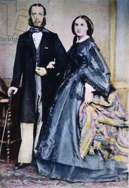 MAXIMILIAN (1832-1867) Archduke of Austria and Emperor of Mexico, 1864-67. With Empress Carlota (1840-1927). Oil over a photograph, c.1864.