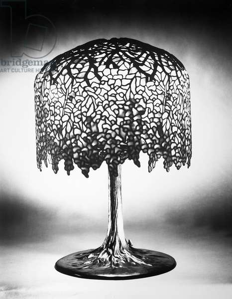 TIFFANY LAMP Wisteria leaded glass and bronze table lamp in the form of a tree, by Louis Comfort Tiffany, c.1900.