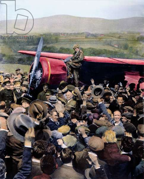 AMELIA EARHART (1898-1937) American aviator. Earhart on landing in her Lockheed Vega at Culmore, Northern Ireland, becoming the first woman to fly alone across the Atlantic. Oil over a photograph, 21 May 1932.