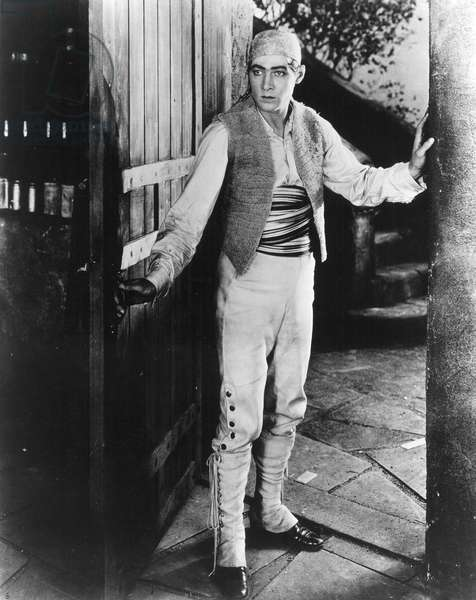 RUDOLPH VALENTINO (1895-1926). American (Italian-born) film actor. In a scene from the film 'Blood and Sand,' 1922.