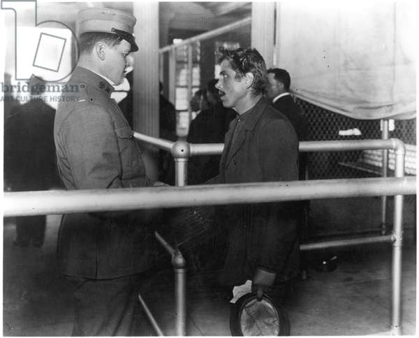 IMMIGRANTS: ELLIS ISLAND An Italian immigrant encounters an immigration inspector, c.1900.