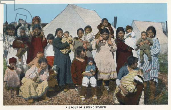 ALASKA: NATIVE AMERICANS A group of Native American women and children in Alaska. Postcard, c.1938.