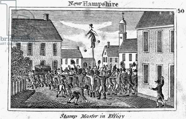 STAMP ACT: PROTEST, 1765 A New Hampshire stamp agent hanged in effigy during an anti-Stamp Act protest in 1765. Line engraving, 1829.