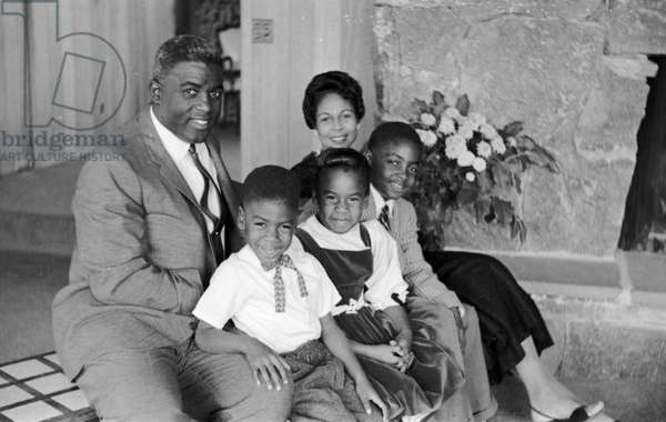 JACKIE ROBINSON (1919-1972) American baseball player. With his wife Rachel and their children David, Sharon, and Jackie Jr. Photograph by Arthur Rothstein, 1945.