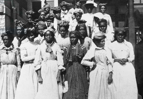 ELLIS ISLAND: WEST INDIANS Guadalupe women (French West Indies) recently arrived at Ellis Island, New York. Photographed c.1900.