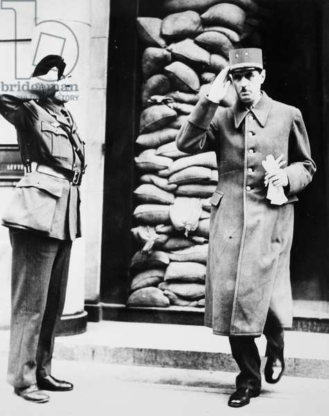 CHARLES DE GAULLE (1890-1970) French soldier and statesman. General De Gaulle salutes a sentry at his London, England, headquarters, 1942.