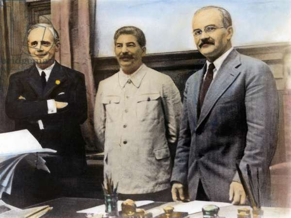 NAZI-SOVIET PACT, 1939 Joachim von Ribbentrop (left), German Minister for Foreign Affairs, Joseph Stalin (center), and Soviet Foreign Minister Vyacheslav Molotov (right), after the signing of the Nazi-Soviet non-aggression pact at Moscow, 23 August 1939. Oil over a photograph.