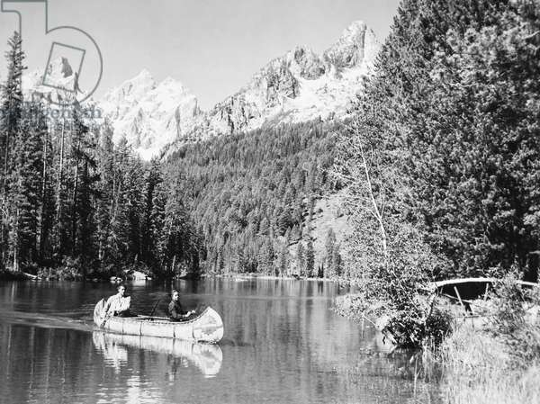 CANOEING, 1952 Stewart Granger, in stern of the canoe, in a still from the film 'The Wild North,' 1952.