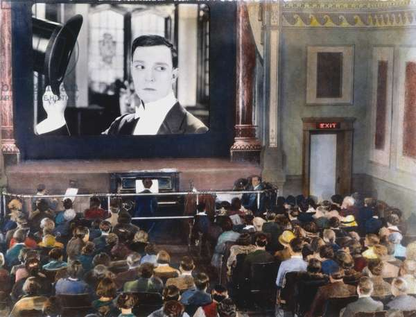 MOVIE THEATER, 1920s Interior of an unidentified New York City motion picture theatre showing a film with Buster Keaton. Oil over a photograph, 1920s.