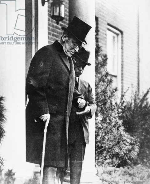 WOODROW WILSON (1856-1924) 28th President of the United States. President Wilson steps out of a doorway. Photographed c.1920.