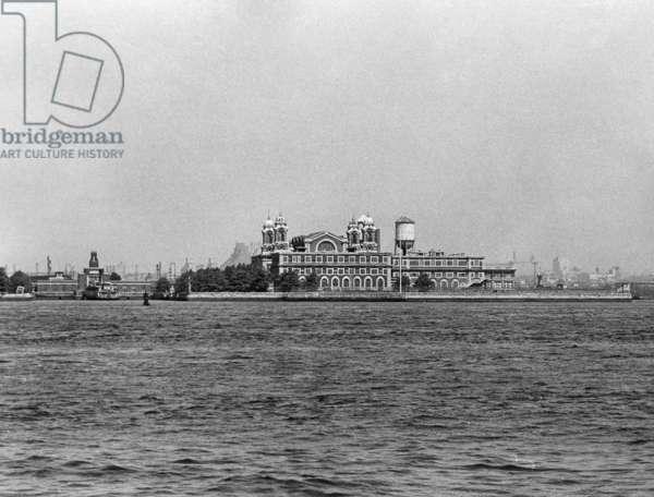 ELLIS ISLAND, 1962 A view of the main building on Ellis Island. Photograph, 1962.