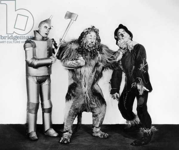 WIZARD OF OZ, 1939 Jack Haley as the Tin Woodman, Bert Lahr as the Cowardly Lion, and Ray Bolger as the Scarecrow in the 1939 MGM production of 'The Wizard of Oz.'