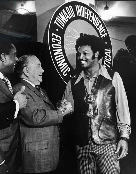 JESSE JACKSON (1941- ) American civil rights leader. Jackson shaking hands with Chicago mayor Richard Joseph Daley, 1971. Photograph by Pete Peters.