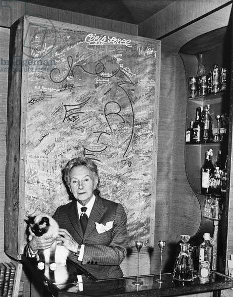 ERTÉ (1892-1990) Pseudonym of Romain de Tirtoff, French (Russian-born) artist and designer. Photographed with his Siamese cat in his apartment in the Paris suburb of Boulogne-Billancourt, 1973.
