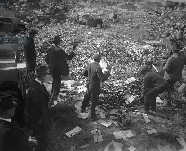LIQUOR RAID, 1923 Group of men destroying bootleg liquor and beer during Prohibition in America. Photograph, 20 November 1923.