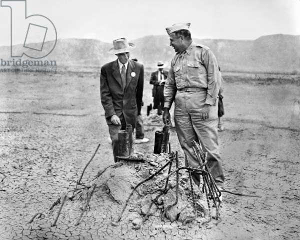 J. ROBERT OPPENHEIMER (1904-1967). American physicist. Oppenheimer (left) as scientific director of the Manhattan Project during World War II, inspecting an atomic test site in the desert at Los Alamos, New Mexico, with Major General Leslie Groves (1896-1970), the project's military director.
