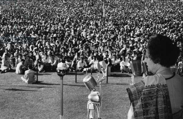 INDIRA NEHRU GANDHI (1917-1984). Indian political leader. Addressing a crowd at Srinagar, India. Photograph, 1970.