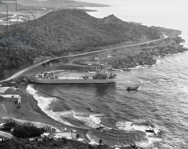 CUBAN MISSILE CRISIS, 1962 The USS Terrebonne Parish (LST-1156) tank landing ship docking at Windmill Beach, Guantanamo Bay, Cuba, during the Cuban Missile Crisis, 2 November 1962.