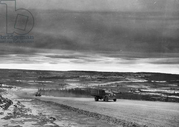 ALASKA: ALCAN HIGWHAY A convoy of trucks on the Alaska Highway, c.1955.