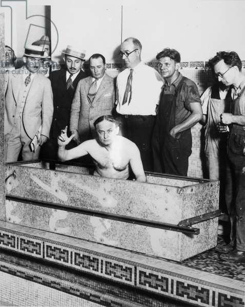HARRY HOUDINI (1874-1926) American magician. Houdini entering the galvanized casket at the swimming pool of the Hotel Shelton, New York City, 5 August 1926.