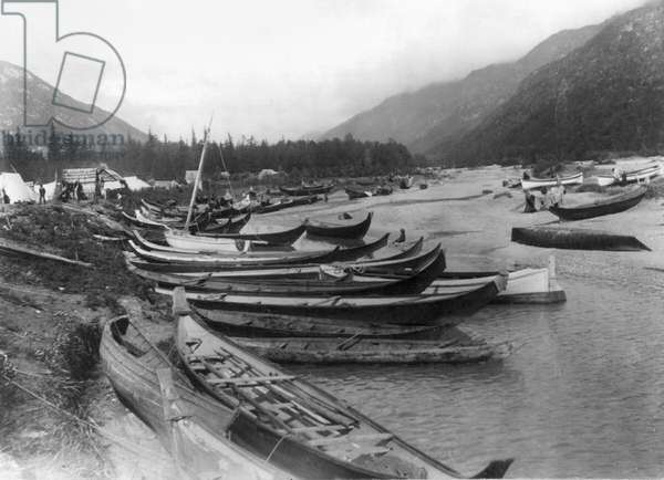 ALASKA: CANOES, c.1897 Forty Native American canoes on a lake in Dyea, Alaska. Photograph, c.1897.