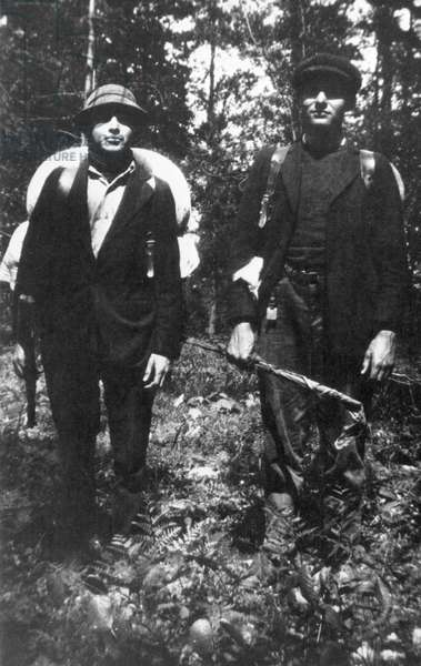 ERNEST HEMINGWAY (1899-1961). American writer. Hemingway, right, photographed on Mighigan's Upper Peninsula, 1917.