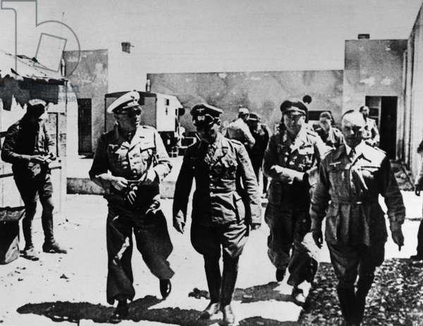 LIBYA: ROMMEL & KESSELRING German field marshals Erwin Rommel (center) and Albert Kesselring, somewhere in Libya during World War II, c.1942.