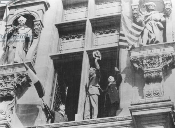 CHARLES A. LINDBERGH (1902-1974). American aviator. Charles A. Lindbergh acknowledging the plaudits of Paris from a balcony of the American Embassy after his successful solo trans-Atlantic flight of 20 May 1927.