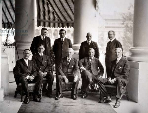 WOODROW WILSON (1856-1924) 28th President of the United States. President Woodrow Wilson at the White House with some of his advisers, including Treasury Secretary William Gibbs McAdoo (front row, second from left); Bernard Baruch (front row, far right), and Herbert Hoover (back row, far left).