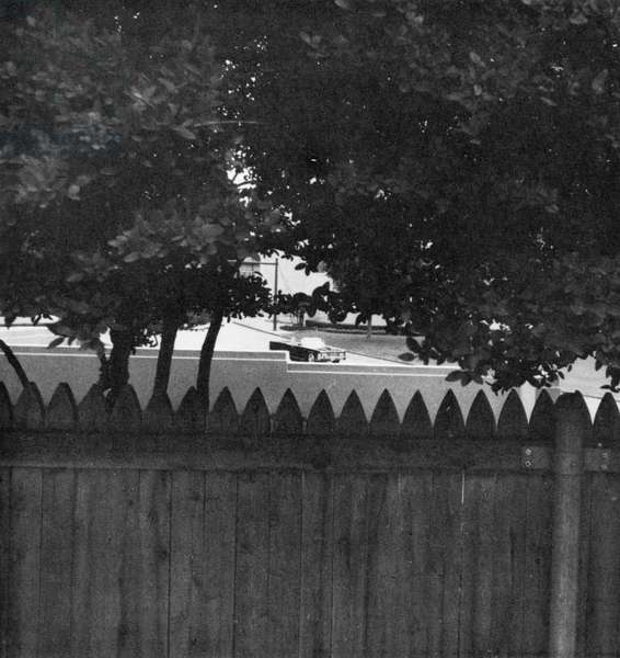 KENNEDY ASSASSINATION, 1963 Photograph of what would have been a gunman's view of the John F. Kennedy's car if he had been hidden behind the fence on the grassy knoll at the time of Kennedy's assassination in Dallas, Texas, 22 November 1963. Photograph by Stephen White, 1968.