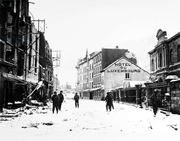 BATTLE OF THE BULGE, 1945 U.S. troops looking for snipers in La Roche, Belgium, 15 January 1945, after taking the town in a joint operation with British forces.