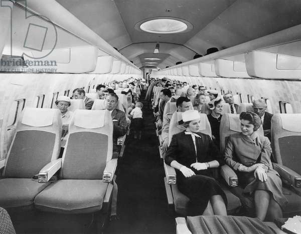 BOEING 707 AIRPLANE Interior of a Pan American Boeing 707: photograph, 1960s.