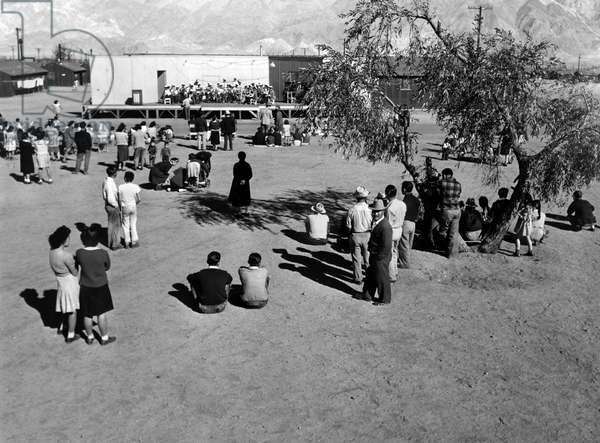 JAPANESE INTERNMENT, 1943 Band concert at the Manzanar Relocation Center for Japanese-Americans at Owens Valley, California. Photograph by Ansel Adams, 1943.