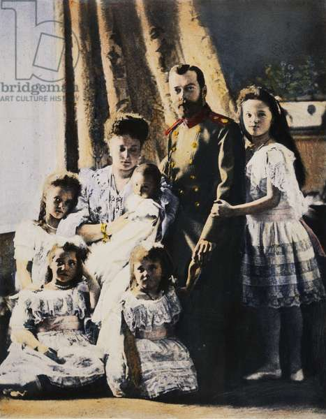 CZAR NICHOLAS II & FAMILY Czar Nicholas II of Russia with the Czarina Alexandra and their children in 1905. Oil over a photograph.
