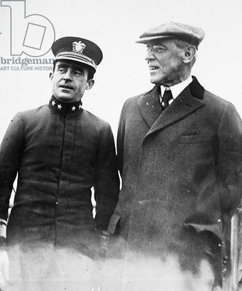 WOODROW WILSON (1856-1924) 28th President of the United States. Wilson (right) with his physician, Rear Admiral Cary T. Grayson, on their return to Washington, D.C., following Wilson's collapse in Colorado on 25 September 1919 during his speaking tour on behalf of the Versailles Treaty and the League of Nations.