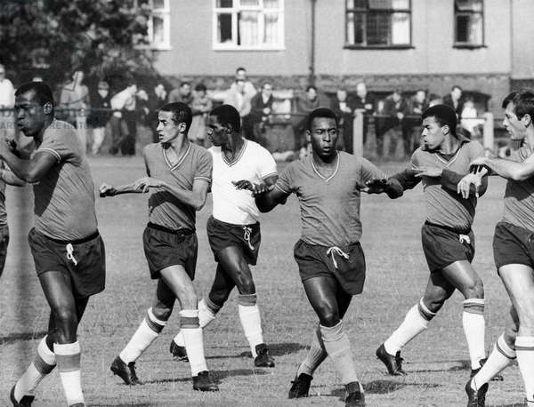 SOCCER PRACTICE, 1966 The Brazilian soccer team practicing for the 1966 World Cup tournament in England. Pelé is third from right.