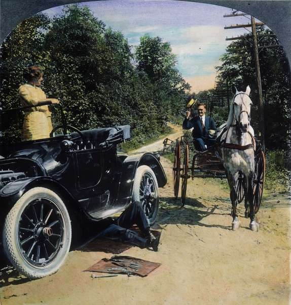 MODEL T FORD, 1914 Model T Ford versus horse and buggy: Panel from an American stereograph, 1914.