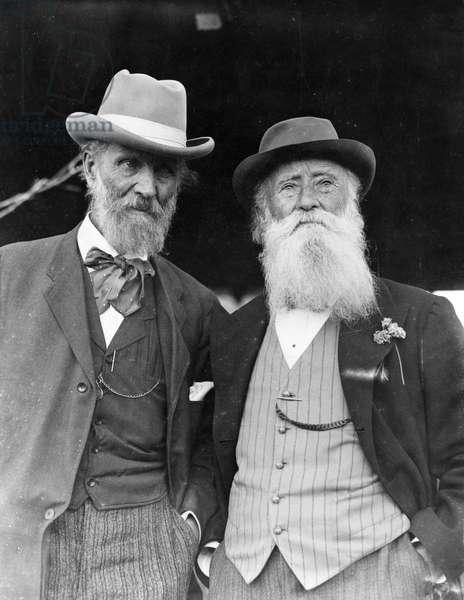 MUIR & BURROUGHS, 1912 American naturalists John Muir and John Burroughs. Photographed on Burroughs' 75th birthday, 1912.