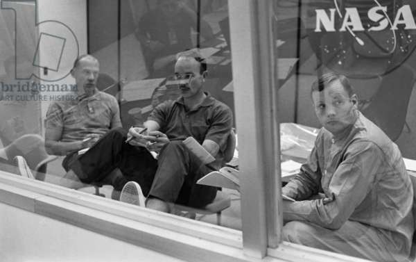 APOLLO 11, 1969 Astronauts Edwin 'Buzz' Aldrin, Michael Collins and Neil Armstrong during a debriefing while in quarantine following their Apollo 11 mission. Photograph, 27 July 1969.