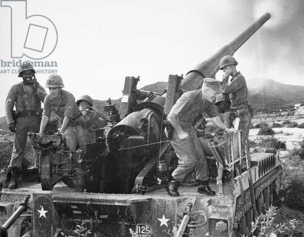 VIETNAM WAR: ARTILLERY Soldiers at a U.S. Army installation near Chu Lai, Vietnam, firing a cannon, 1966.