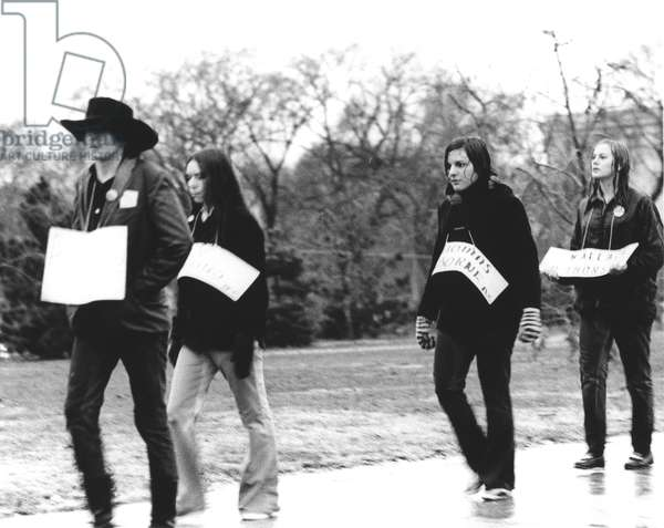 ANTI-WAR PROTEST, 1969 Young people carrying signs of soldiers killed in Vietnam walk in the rain to protest the war during a 600,000-strong demonstration in Washington, D.C., on 15 November 1969.
