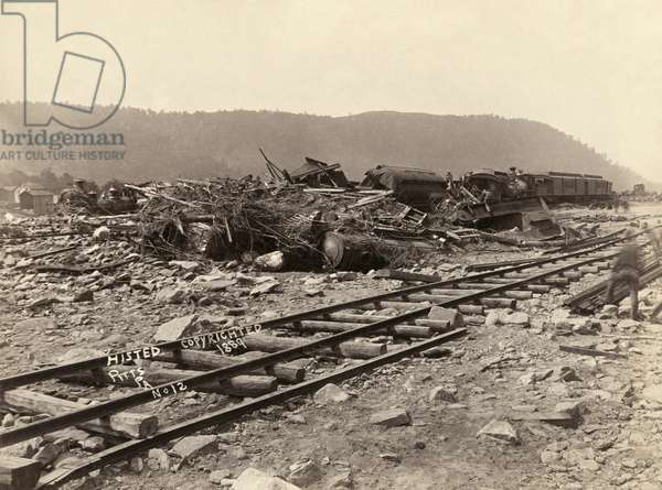 JOHNSTOWN FLOOD, 1889 A wreck of Pullman cars and engines at Conemaugh in Johnstown, Pennsylvania, after the Johnstown Flood. Photograph by Ernest Walter Histed, 1889.