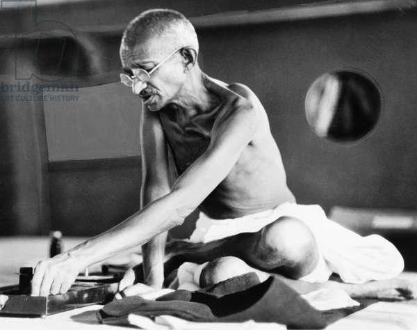 MOHANDAS GANDHI (1869-1948) Hindu nationalist and spiritual leader. Photographed en route to London, England, 1931.