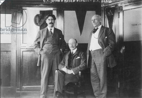 ERNEST THOMPSON SETON (1860-1946). American (English born) naturalist and writer. Photographed, left, with Robert Baden-Powell, seated, and Daniel Carter Beard, n.d.