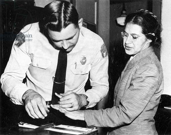 ROSA PARKS (1913-2005) American civil rights advocate. Rosa Parks fingerprinted by Lieutenant Drue H. Lackey in Montgomery, Alabama, 22 February 1956, following her arrest for her role in organizing a boycott of the city's buses to protest their racial segregation of passengers.